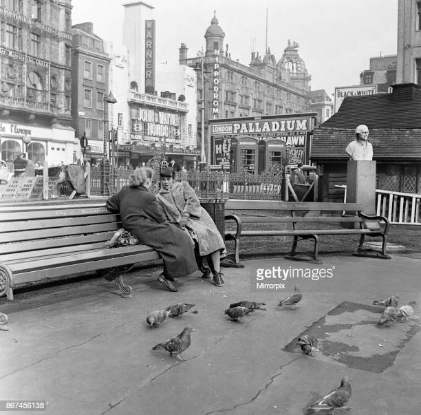 Feeding birds in Leicester Square London during lunch hour 8th March 1954