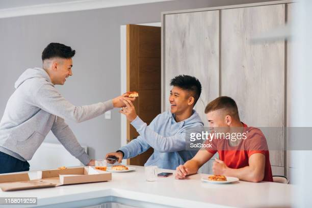 feeding friends - teenagers only stock pictures, royalty-free photos & images