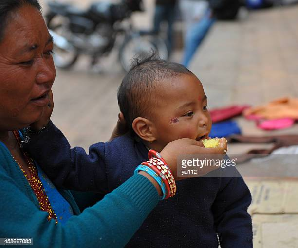feeding - nepalese ethnicity stock pictures, royalty-free photos & images