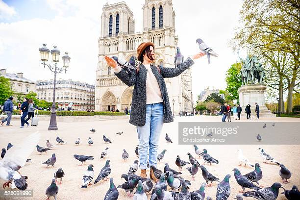 Feeding Pigeons at Notre Dame Cathedral Paris France