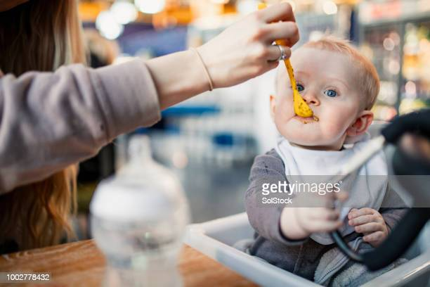 feeding the baby boy - simple living stock pictures, royalty-free photos & images