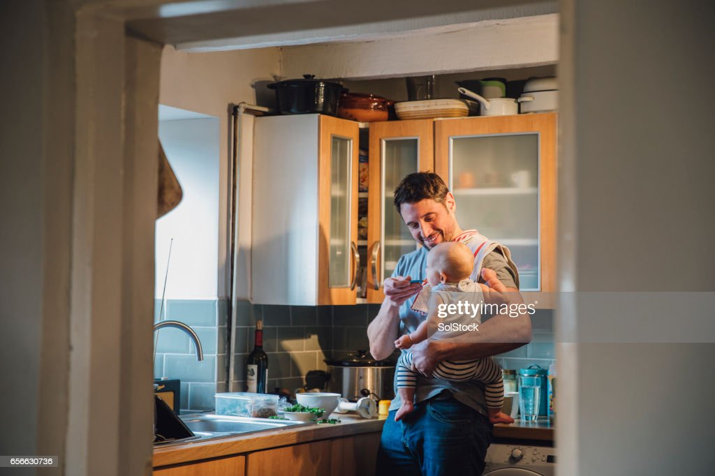 Feeding The Baby : Stock Photo