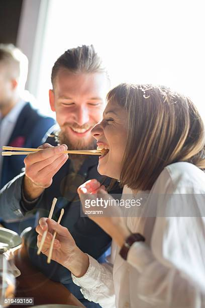 feeding with sushi - light effect stock pictures, royalty-free photos & images