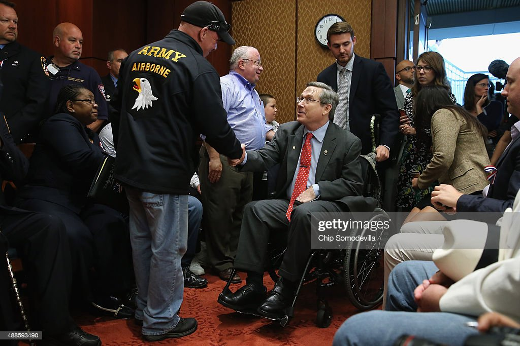 Feel Good Foundation founder John Feel greets Sen. Mark Kirk (R-IL) during a news conference to demand that Congress extend the Zadroga 9/11 health bill at the U.S. Capitol September 16, 2015 in Washington, DC. Comedian and former Daily Show host Jon Stewart joined ailing police and firefighters in lobbying Congress for a permanent extension of the Zadroga Act's $1.6 billion health and monitoring effort for the 72,000 emergency responders who worked at Ground Zero.