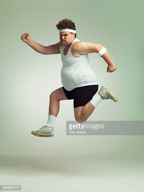 i feel in shape already - chubby men stock photos and pictures