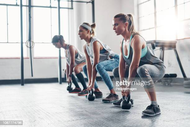 feel it working in your core - circuit training stock photos and pictures