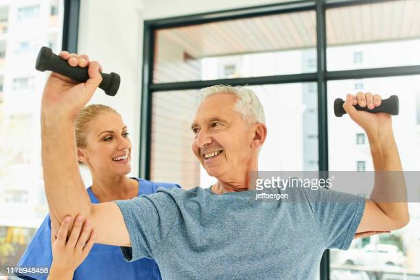 i feel stronger already - osteoporosis stock pictures, royalty-free photos & images