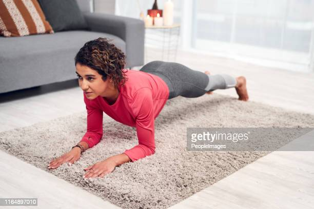 feel the burn! - plank exercise stock pictures, royalty-free photos & images