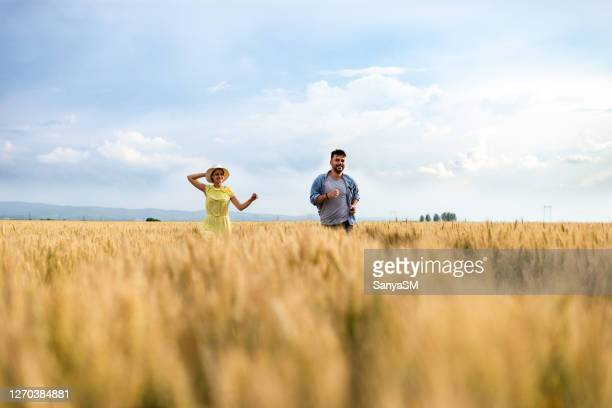 feel the freedom! - yellow dress stock pictures, royalty-free photos & images