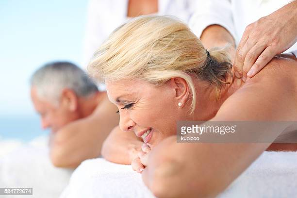 feel the stress leaving your body - husband massage wife stock photos and pictures