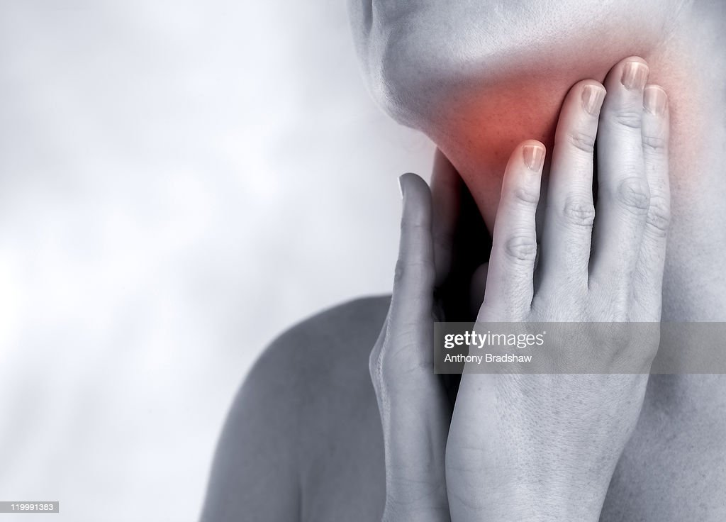 Feeling a sore throat. : Stock Photo