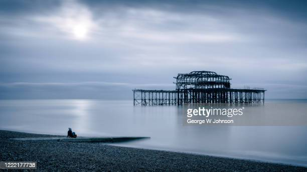 feeling blue at the pier - brighton beach england stock pictures, royalty-free photos & images