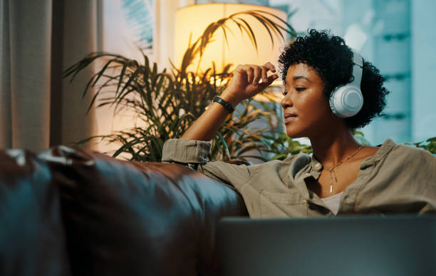 feeling bored? technology can take care of that - listening to music stock pictures, royalty-free photos & images