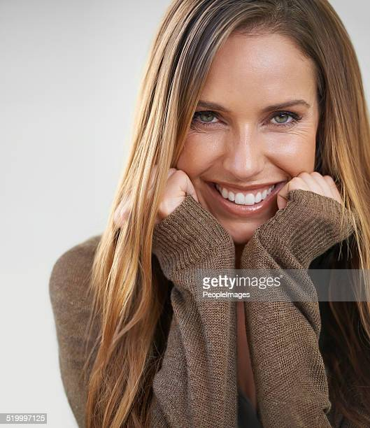 feeling cheerful - mid adult woman sweater stock pictures, royalty-free photos & images