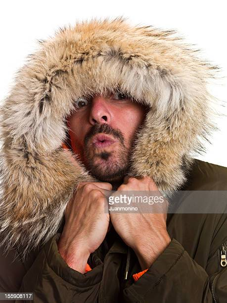feeling cold - parka coat stock photos and pictures