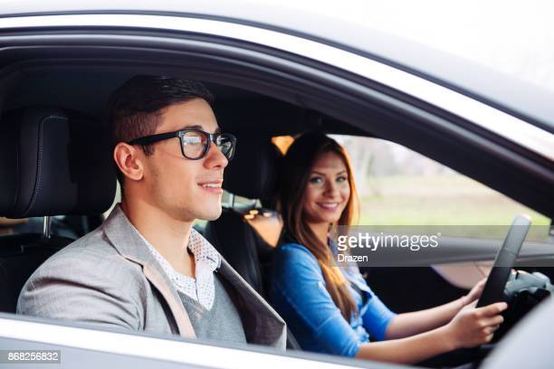 feeling confident with expert driving instructor - car pooling stock photos and pictures