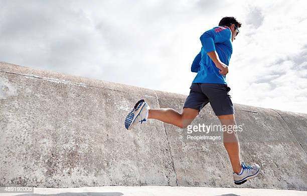 feeling good and keeping fit! - striding stock pictures, royalty-free photos & images