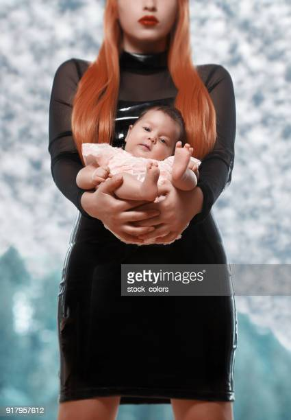 feeling great in my mother's arms - black ginger baby stock photos and pictures