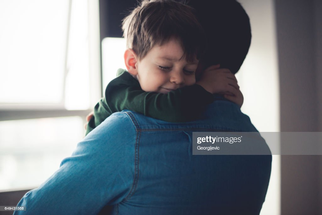 Feeling happy in dad's arms : Stock Photo