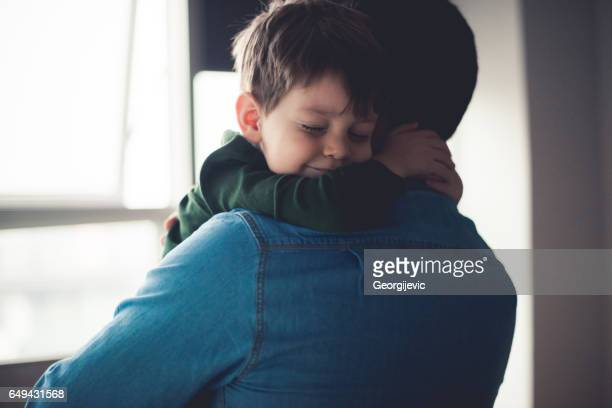 feeling happy in dad's arms - embracing stock pictures, royalty-free photos & images