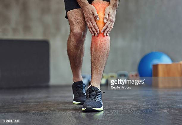 feeling it in the knee - human knee stock pictures, royalty-free photos & images