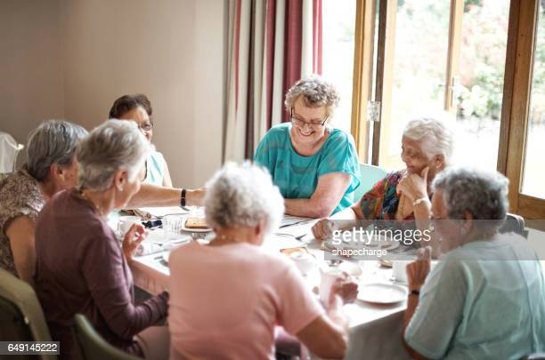 feeling jovial at the breakfast table - senior lunch stock photos and pictures