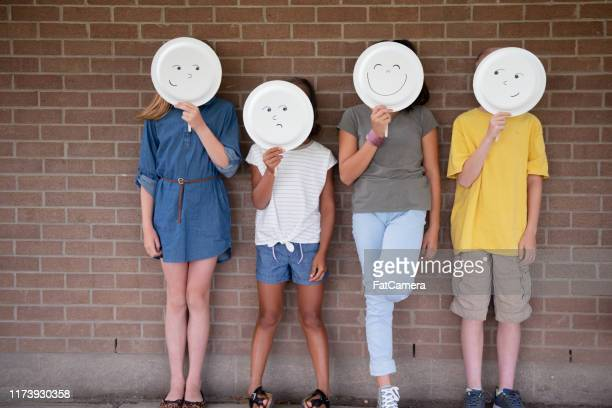 feeling left out in school - paper plate stock photos and pictures
