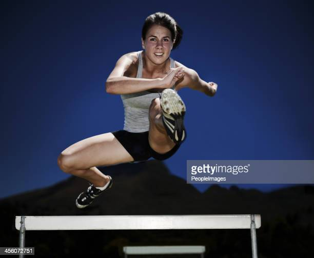 feeling like a fitness warrior - hurdle stock photos and pictures