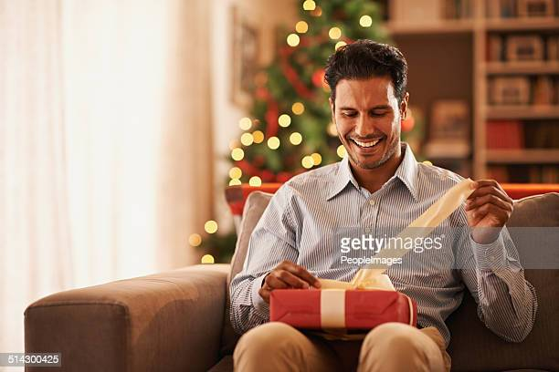 feeling like a kid on christmas - christmas gifts stock photos and pictures