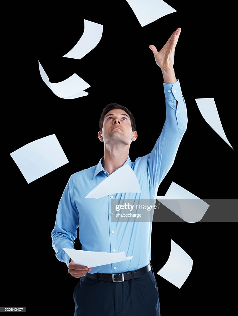 Feeling overwhelmed by all the paperwork : Stock Photo