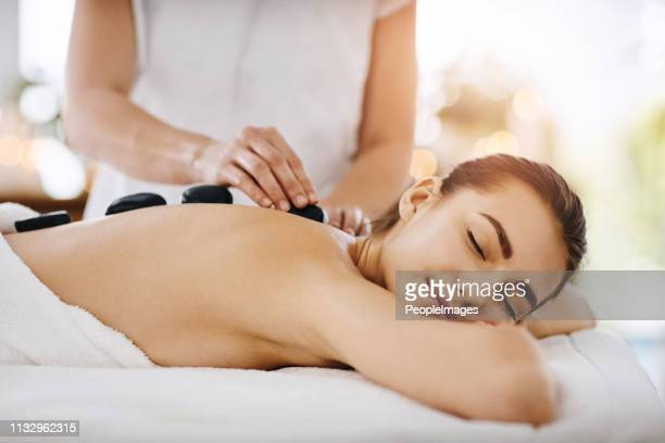 feeling relaxed as the heat hits my body - massage therapist stock pictures, royalty-free photos & images