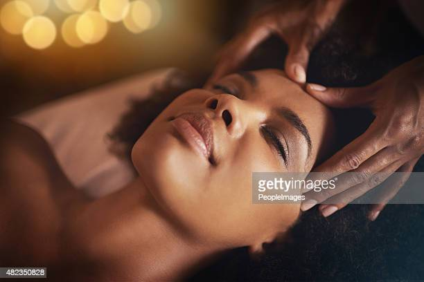 feeling so pampered - massage black woman stock photos and pictures