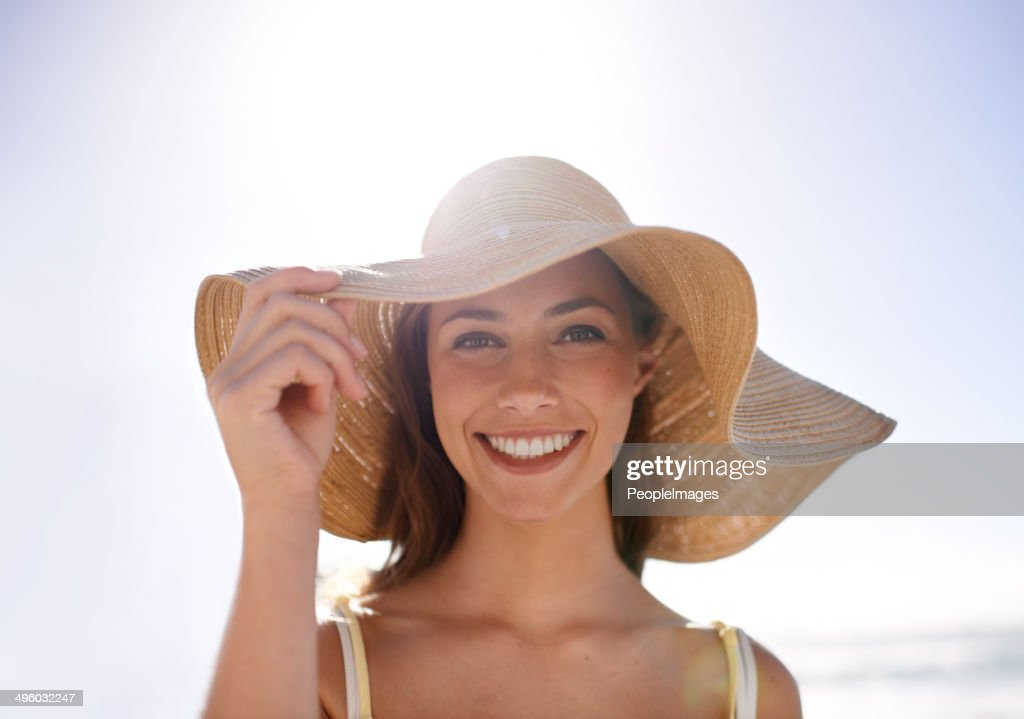 Feeling summery in her sunhat : Stock Photo