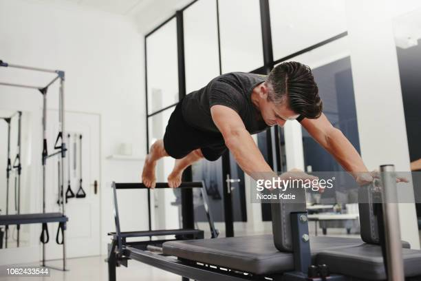 feeling that extra burn - pilates stock pictures, royalty-free photos & images