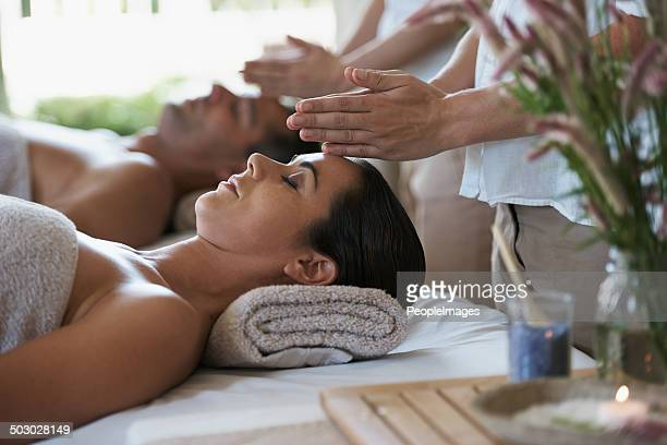 feeling the calming energy - husband massage wife stock photos and pictures