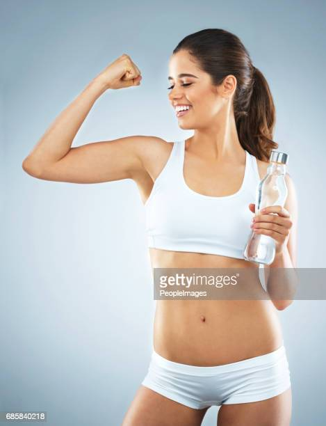 feeling the glory from reaching her fitness goal - lap body area stock photos and pictures