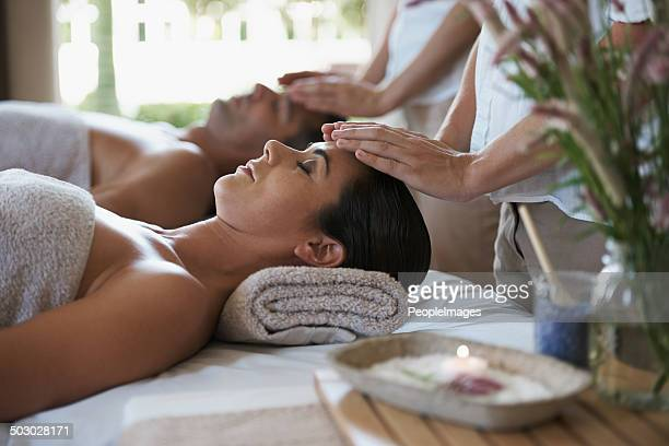 feeling the healing through their expert hands - husband massage wife stock photos and pictures