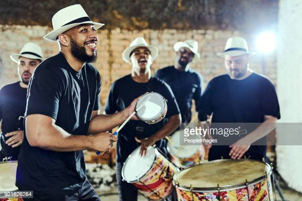 feeling the rhythm in the drums - brazilian men stock photos and pictures