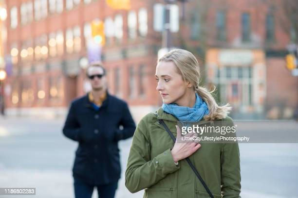 feeling unsafe when walking - stranger stock pictures, royalty-free photos & images