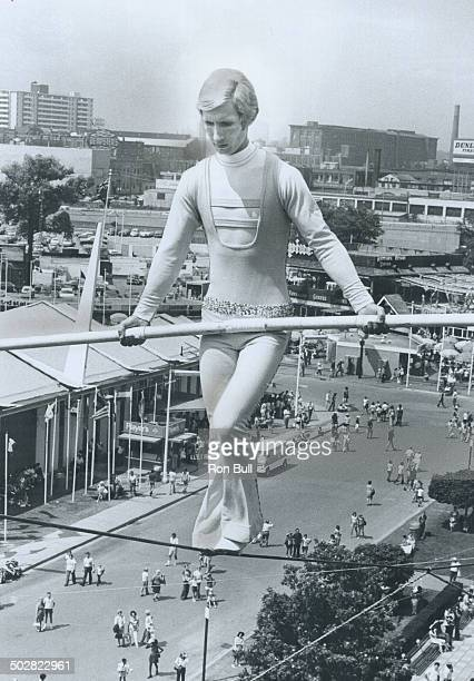120 feet above Canadian National Exhibition Jay Cochrane the Canadian Prince of the Air walks a tightrope from the Hockey Hall of Fame to the roof of...