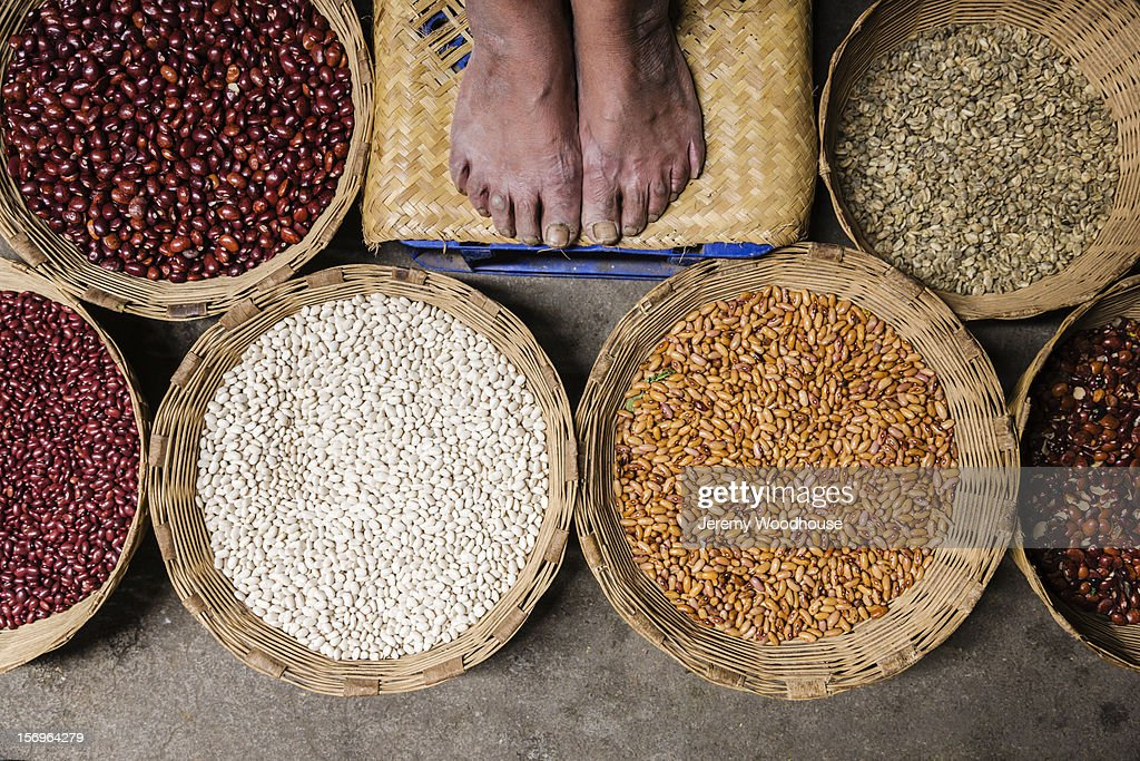 Feet and beans at the Antigua market : Stock Photo