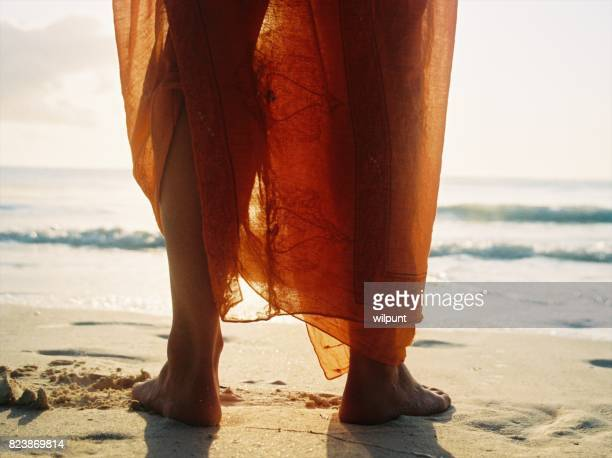 feet and orange sarong - zanzibar stock photos and pictures