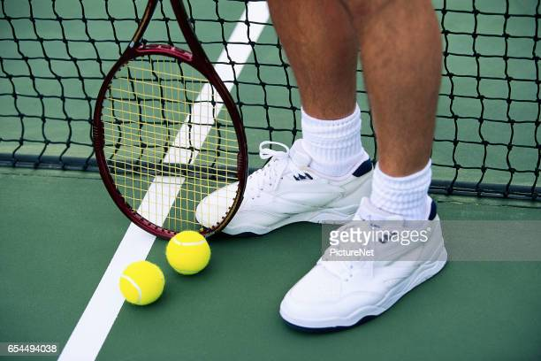 Feet and Shoes of Tennis Player
