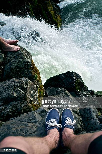 feet at top of waterfall - eugene oregon stock photos and pictures