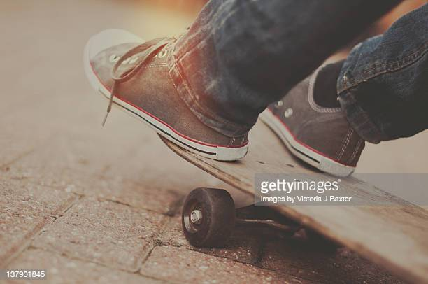 Feet captured on skateboard