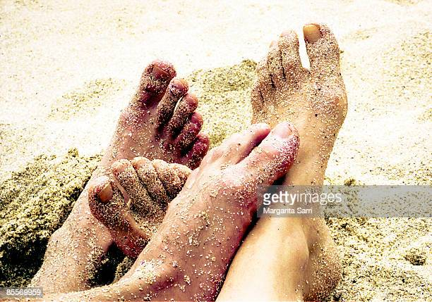 feet composition in sand - margarita beach stock photos and pictures