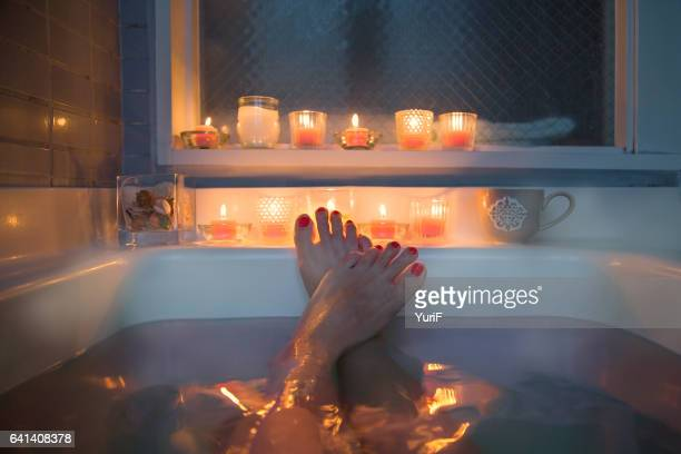 feet in bath - candle stock pictures, royalty-free photos & images