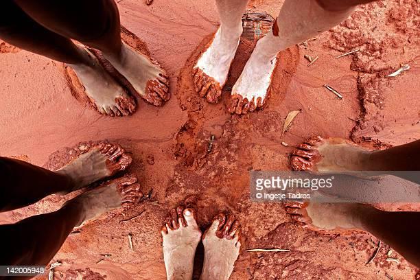 Feet in red sand on beach in Broome, WA