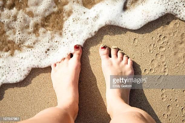 feet in sand at hapuna beach, hi - hapuna beach stock photos and pictures