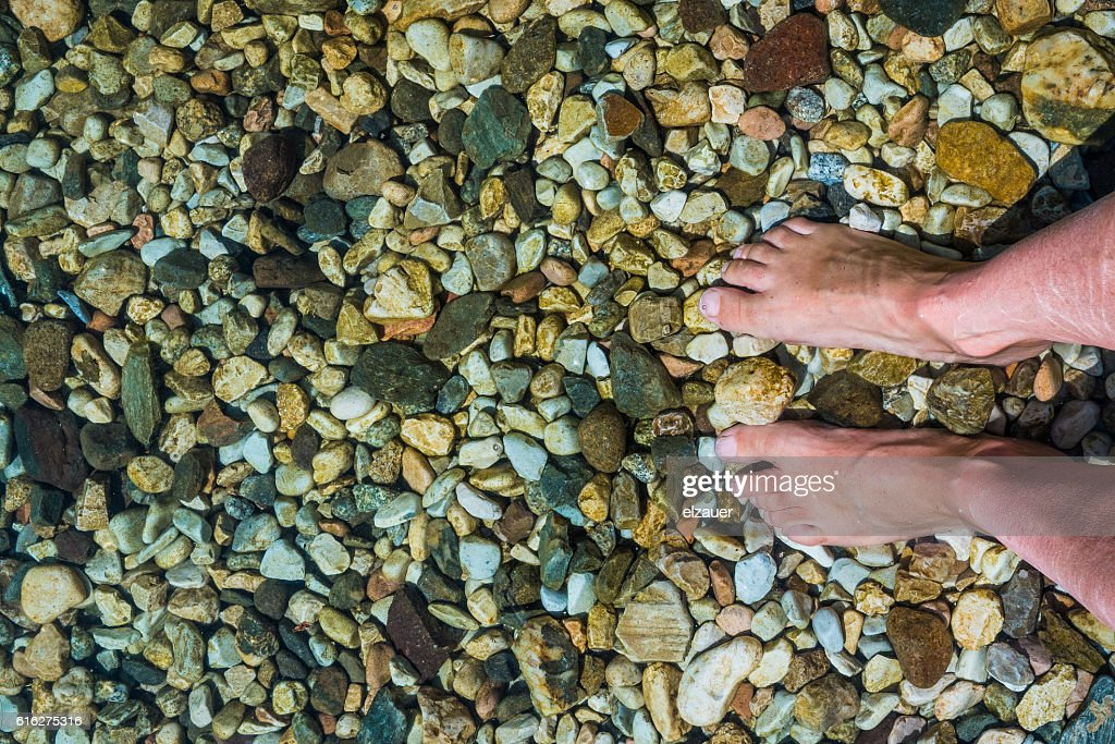 Feet in the water : Stock Photo